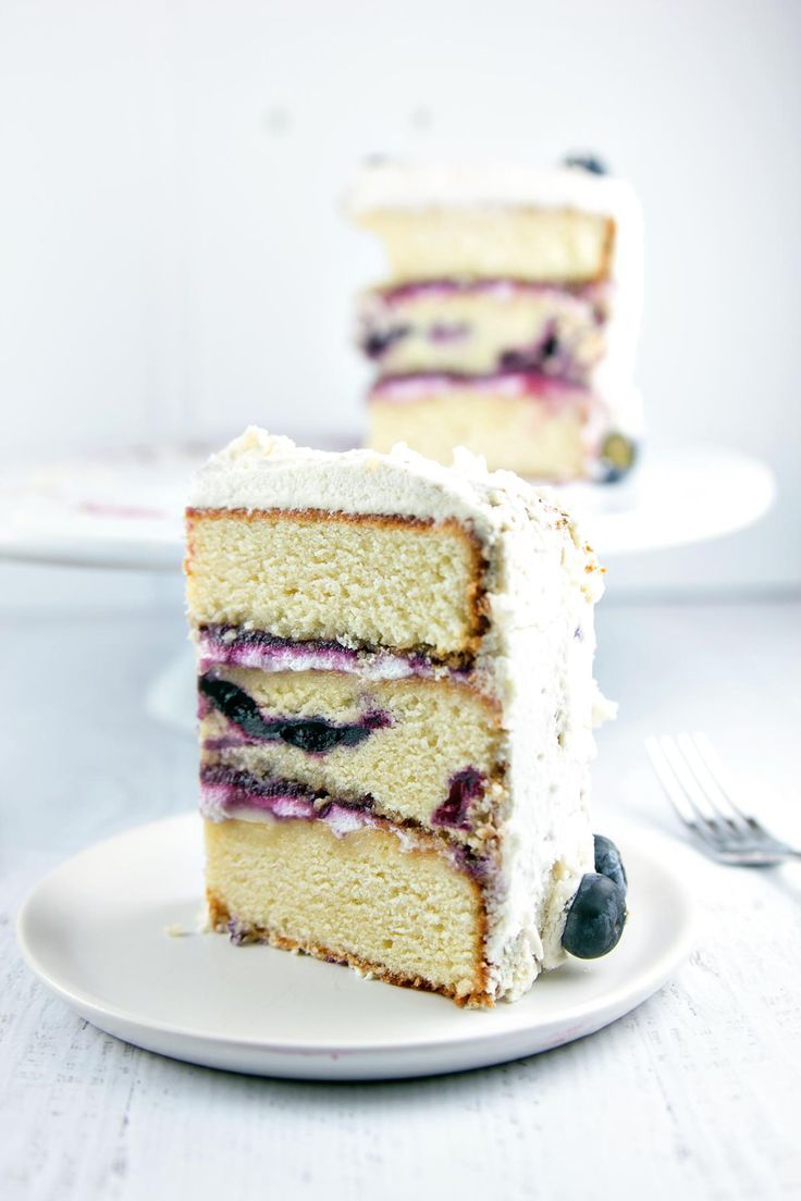 Vanilla Layer Cake with Blueberry Cardamom Curd: A three-layer blueberry vanilla cake filled with blueberry cardamom curd and covered with whipped cream. Simple flavors combine to make a spectacular dessert! {Bunsen Burner Bakery}
