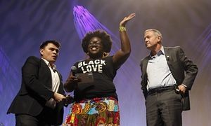 O'Malley and Sanders interrupted by Black Lives Matter protesters in Phoenix -  Tia Oso of the National Coordinator for Black Immigration Network joins Jose Vargas and Martin O'Malley onstage. -  July 18, 2015