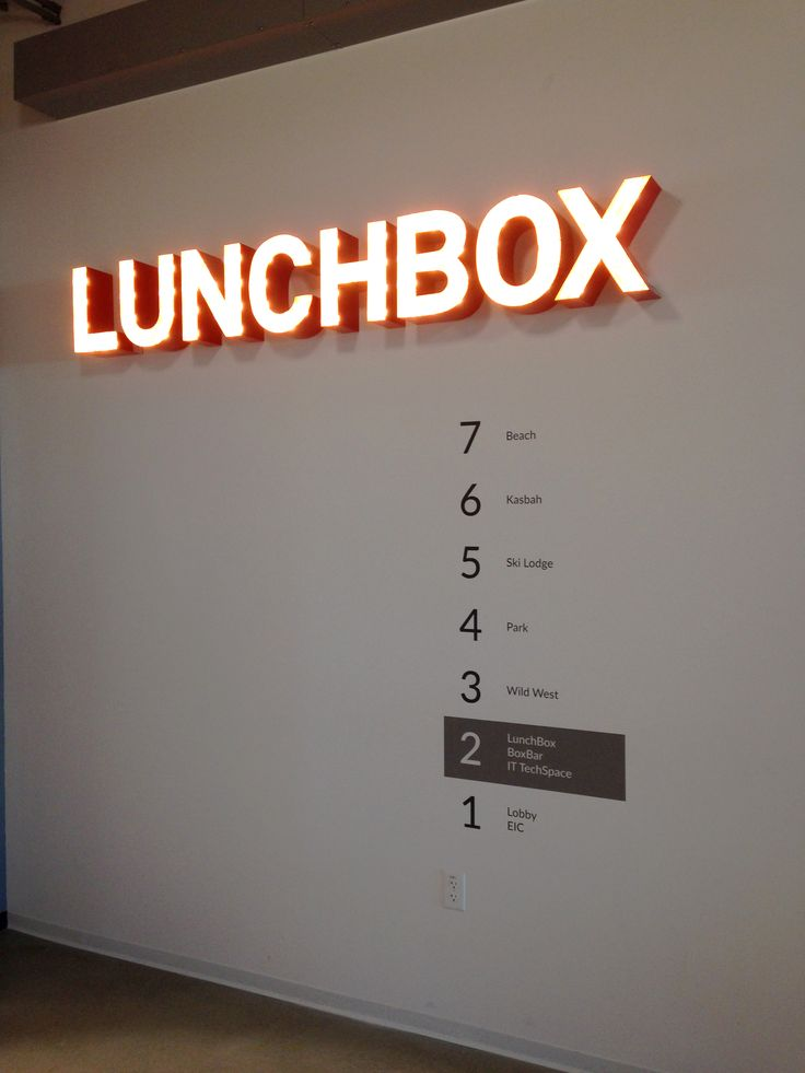 Lighted signage and vinyl wayfinding for the cafeteria floor at Box's Redwood City offices #signage #EGD #brandedspace