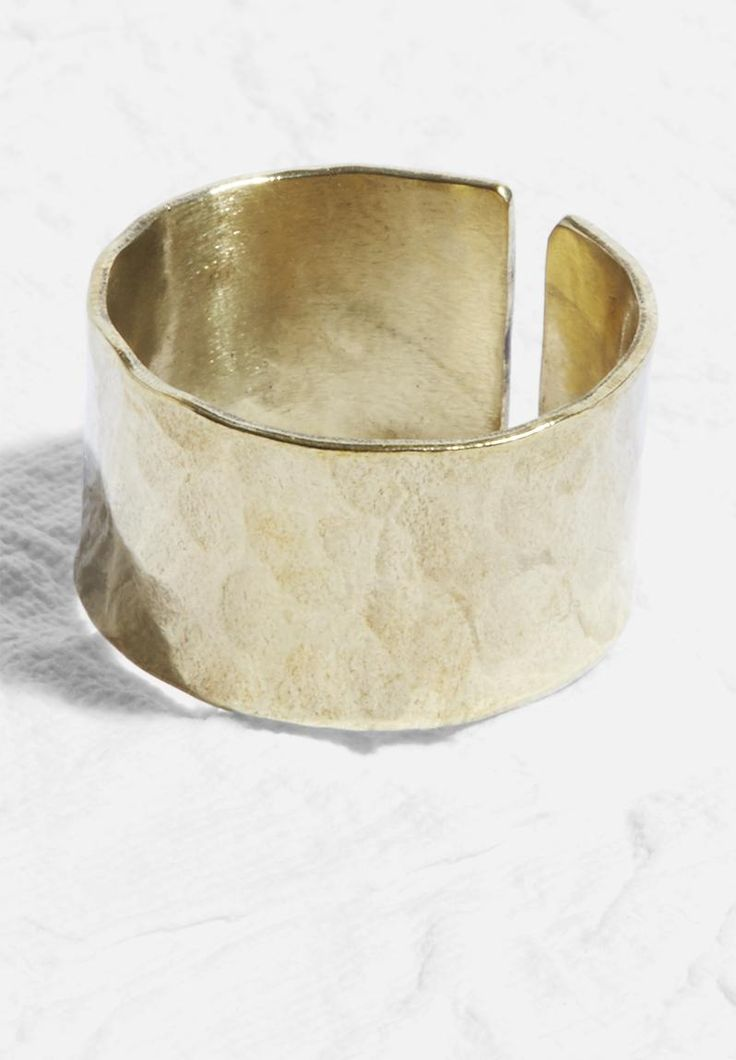 At once rustic and modern, this brass ring epitomises pared-back beauty. It's been finished with an open top and has been hand hammered into shape, meaning no two look quite the same.