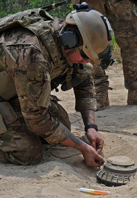 An U S Navy Explosive Ordnance Disposal Technician
