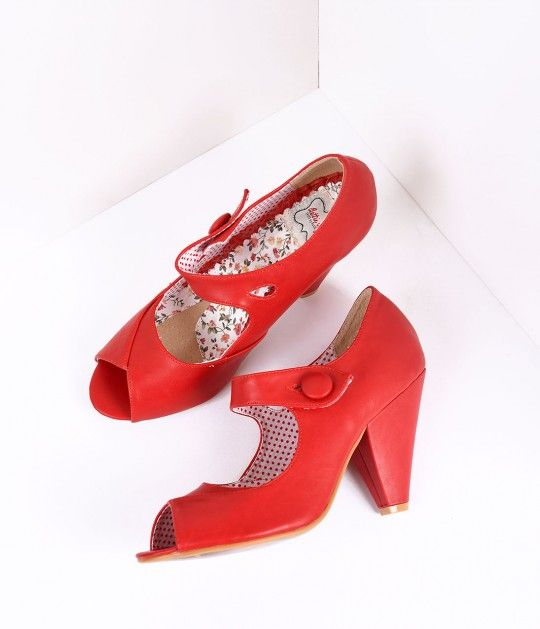 Shelly has our full attention, darlings! These vintage inspired red Mary Jane pumps are crafted in leatherette and feature a flirty peep toe and 4 heel for a gorgeous lift. The charming strap secures with a large button while the soft cushion interior ke