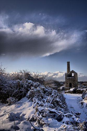 The snow-covered engine house of the South Cundurrow Mine, a relic of Cornwall's rich mining past, that can be found about a mile from the centre of Camborne in the west of the county.