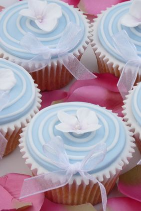blue lid with flower center and bow cupcakes - inspiration only - bjl