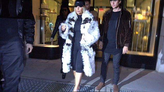 Kim Kardashian went shopping in New York the day after husband Kanye West released his new album and clothing line.