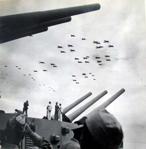 Air Group #1 from the carrier Bennington flies between the big guns of the Battleship Missouri during the surrender ceremony in Tokyo Bay ending WWII. This is Hieber's squadron leading the flyover of 1200 planes