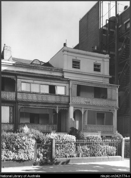 Old terrace houses next to [the then extant] Ritz mansions at Fitzroy Street, St Kilda, Melbourne, Victoria, 1959 [picture]. Photo by Wolfgang Sievers.