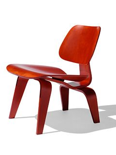 Eames Molded Plywood Lounge Chair in red. I want one of these for the corner of my living room like you wouldn't believe. To the point of considering buying a knock-off till I can afford the real deal.
