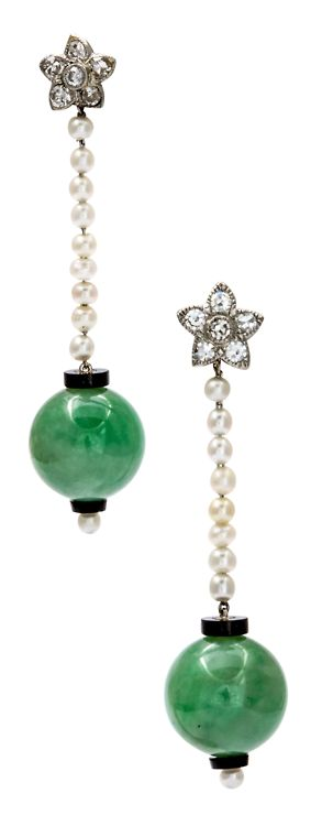 Art Deco Jade Earrings. The jade orbs are a voluptuous, natural candy green. The pearls are natural of beautiful matching color. Petite diamond flowers cover the entrance to your ear which is accomplished with posts of gold. Homage to Art Deco design is paid with the bit bit of black onyx kissing the jade, a recognizable Art Deco touch. Movement, beauty and lightness in a pair of earrings. Excellent condition c. 1920. Via 1stdibs.