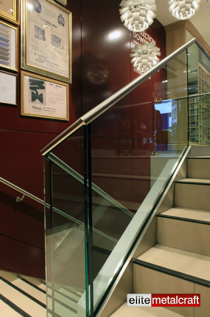 Toughened Glass balustrade, Stainless Steel Handrails and mild steel structure. Retail Staircase designed for easy maintenance and to compliment the TM Lewins brand image of quality and design. Main structure fabricated from mild Steel, and having a fibrous plaster soffit to underside of stairs. All exposed stringers clad in satin polished Stainless Steel with 19mm thick toughened Glass Balustrade. Stainless Steel handrail bonded to top of Glass