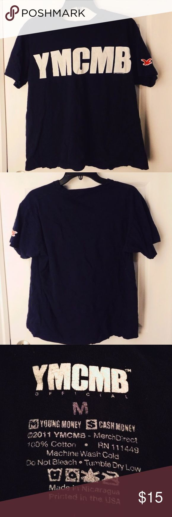 YMCMB T-shirt Officially licensed YMCMB navy tshirt- (young money cash money billionaires) Great condition. I always liked the red bird on the sleeve. Size medium in women's (US) YMCMB OFFICIAL Tops Tees - Short Sleeve