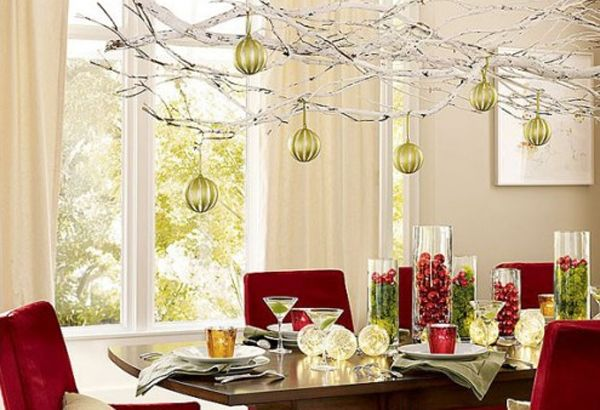 Love the white branches over the  Christmas table... I will hang glittery ornaments off of it.