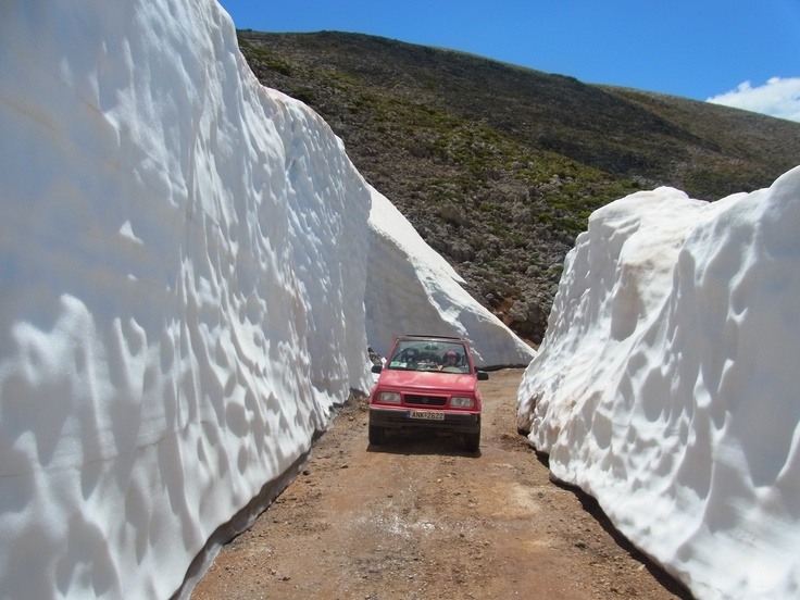 Driving through snow drifts in the high mountains of the Lefka Ori