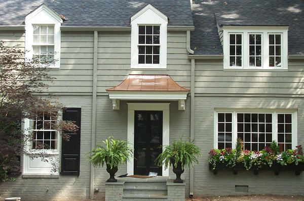 Inspirational house - mosaic tile exterior, dragon's breath shutters/door, white dove trim and copper awning.
