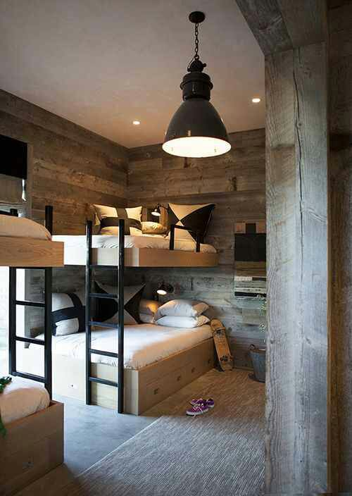 Cozy, modern and rustic mixed wood bunk bedroom