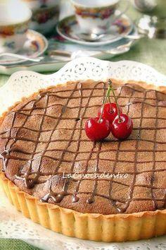 Una crostata che oserei definire...peccaminosa!! :-)Riuscite ad immaginarne la deliziosa bontà?Ciliegie, frangipane e cioccolato racchiusi in guscio di frolla realizzato con la magnifica ricetta di Montersino!Essì, perchè se la ricetta è tratta dal libro di Rosalba Gioffrè, &qout;Cioccolat…
