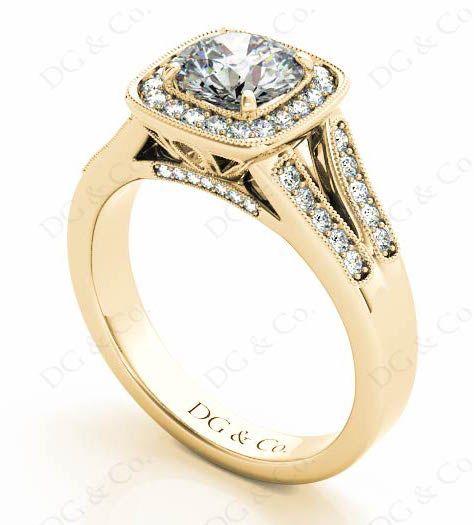 BRILLIANT CUT HALO SET DIAMOND RING WITH PAVE SET SIDE STONES.