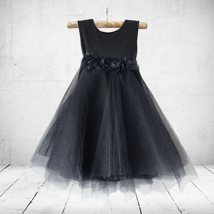 Colours: White, off-white, ivory/cream, black, sand&white, dusty pink  A princess dress with tulle and lace with floral detail on the waistline. The…