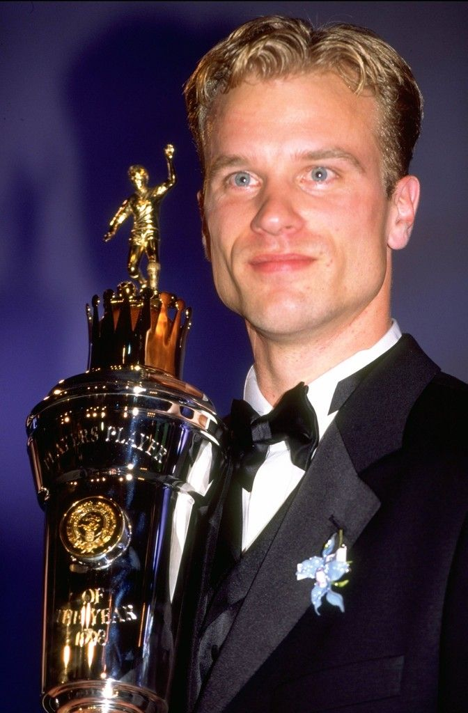 Dennis Bergkamp receiving the Player of the Year trophy at the P.F.A. Awards (5 April 1998)