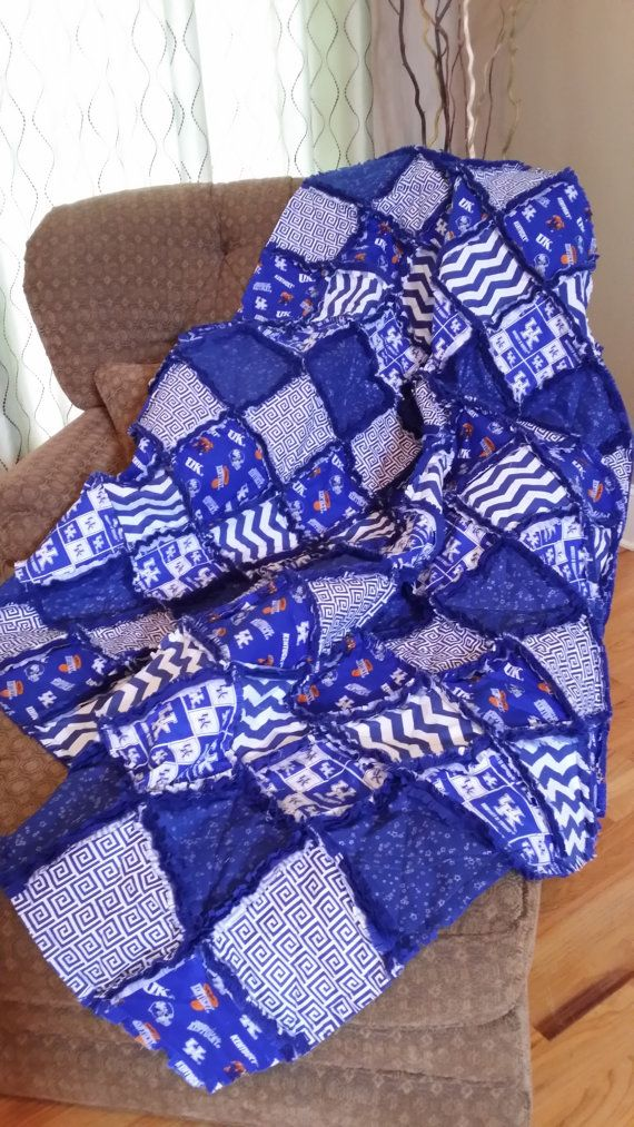 University of Kentucky Rag Quilt Throw Please choose your quantity and size above.  Your personal quilt will be custom made and matching the the X-Large sized throw thats pictured. If for some reason one of the fabrics is no longer available I will replace with a similar fabric.  Rag quilts are simple to wash and dry and will become softer, raggier and more beautiful with each washing. * 100% Cotton front and your choice of Cotton or Flannel backing. * Blocks are sewn with the traditional X…