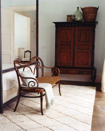 beautiful bentwood + moroccan rug in a coastal guest bedroom via Tom Scheerer