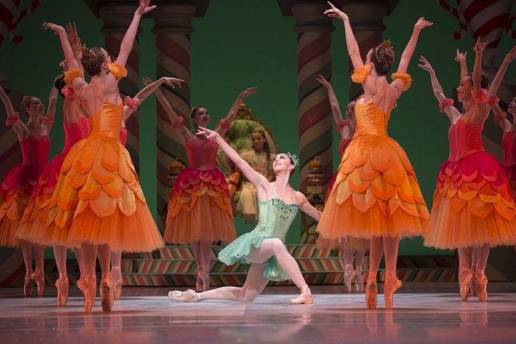 """Pacific Northwest Ballet principal dancer Laura Tisserand as Dewdrop, with company dancers in the Waltz of the Flowers in """"The Nutcracker,"""" choreographed by George Balanchine. (Angela Sterling)"""