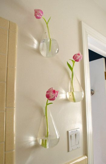this young house- hanging wall vases in bathroom.