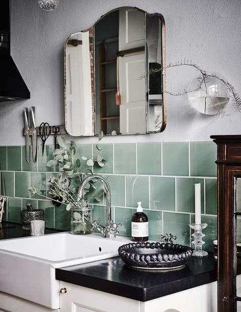 Beautiful mint tile panel in the working are of an vintage kitchen. The dark working surface and a vintage three-part mirror fit perfectly. Head to our blog to learn more about our latest Trend Watch.