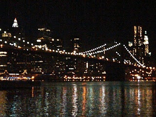 Empire Fulton Ferry Park Brooklyn NY. On our last night in New York a friend took us to this amazing place late at night. You can see most of the bridges, hear the trains overhead, see the Empire State Building, and the water is painted by the lights of the city.