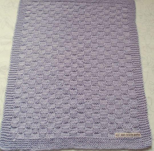 Strikket gæstehåndklæde i sart pastel