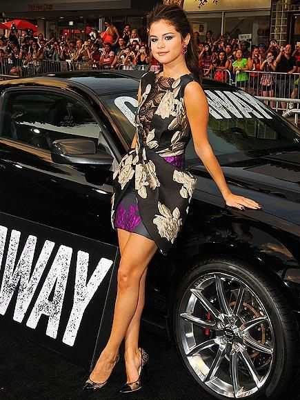 Selena Gomez stuns in another sexy dress at the Los Angeles premiere of her new movie, Getaway – and looks ready to make an escape of her own while leaning against a souped-up car. http://www.people.com/people/gallery/0,,20728683,00.html#30009908