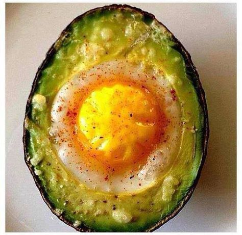 Whole avocado, Eggs, Cayenne pepper (or any spice of your choice). Remove the stone from an avocado. Scoop out a little more avocado to increase the size of the stone's crater. Crack an egg into the crater. Sprinkle with Cayenne pepper (cheese too if you desire). Bake in the oven at 180 degrees until egg is cooked to the level you like.