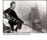 Vintage Summer 1974, Frenchman Phillippe Petit walks across a cable between the unfinished Twin Trade Towers, NYC, www.RevWill.com