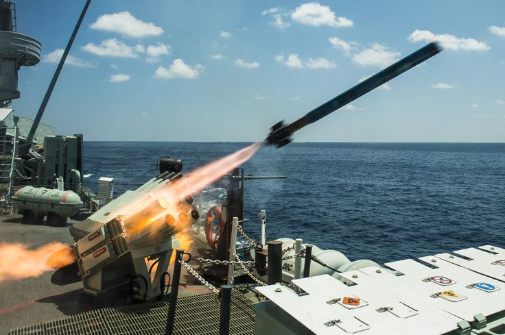 Her Majesty's Canadian Ship REGINA fires an exercise chaff rocket at a simulated target in the waters east of India during Operation ARTEMIS on February 14, 2014.  Photo: Cpl Michael Bastien, MARPAC Imaging Services