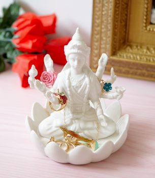 """Kalyana Jewelry HolderIN STOCK NOW!  $64          checkout    wishlist  share  email  You will be blessed as the Hindu goddess of wealth, wisdom and grace watches over your treasured pieces. This statue/jewelry holder is the perfect piece to decorate your nightstand or vanity. Ceramic. 6.2""""x6.2""""x6.25"""""""
