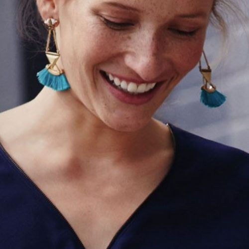 My Shining Armour Teal Tassle Statement Earrings. Two white triangular stones, gold metalwork and teal neon tassels. Shop at http://myshiningarmour.com