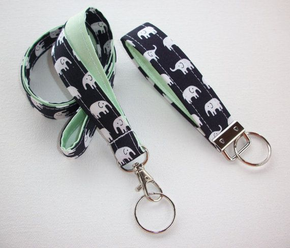 This set consists of - 1 lanyard and 1 key fob Work doesnt have to be all boring - brighten up your wardrobe with these fashionable lanyards, reels, and fobs. ** Lanyard description: measures approx 3/4 inch wide with a 20.5 drop - (41 around with a 1 lobster clasp) If you desire a SHORTER length, please let us know in the note filed when checking out. Our lanyards are made with designer cotton fabric and is reinforced with interfacing. Each lanyard comes with a silver-tone lobster cl...