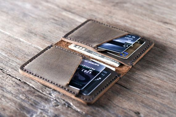 This listing is for one PERSONALIZED card wallet. We have branding awesome INITIALS into the leather down to an exact science. This new front pocket wallet design is slim and fun. ————————————————————— [ PRODUCT FEATURES ] ————————————————————— ✦ When closed is measures 3 by 4.5 by 3/8 (7.5 cm by 11 cm by 1.1 cm) ✦ Holds 8 - 10 cards + folded cash ✦ Made from distressed, full-grain cowhide leather ✦ Our signature hand-stitching Its a really fun wallet that is sure to impress, especial...