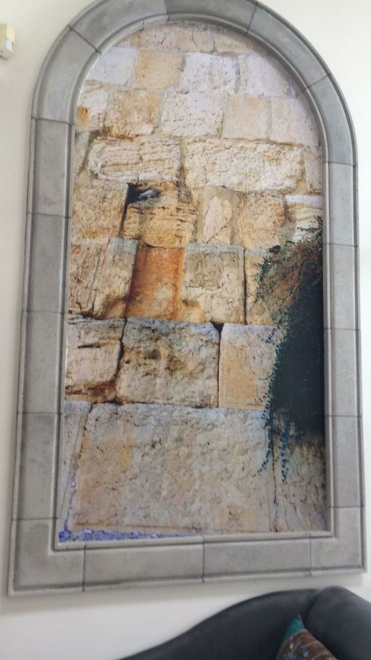 Eastern Wall of the Temple in Jerusalem ( the Wailing Wall) Love the way the bird took refuge under the cross!