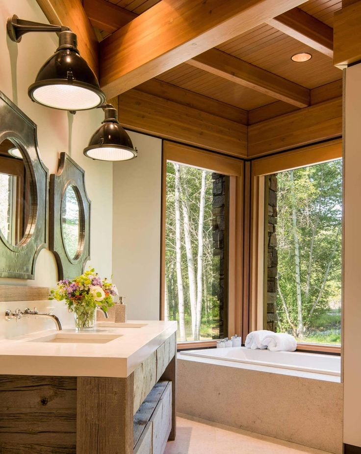 """Mountain home sitting on the banks of the Big Wood River in Ketchum's Northwood neighborhood Architects:Lloyd Construction Location: Ketchum, Idaho, USA Year: 2016 Area: 8.300 ft²/ 771 m² Photo courtesy:Josh Wells Description: """"The 8,300-square-foot home sitting under a hundred 50-foot aspens on the banks of the Big Wood River in Ketchum's Northwood neighborhood isn't just …"""