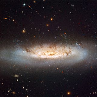 NGC 4522 is a spectacular example of a spiral galaxy that is currently being stripped of its gas content. The galaxy is part of the Virgo galaxy cluster and its rapid motion within the cluster results in strong winds across the galaxy as the gas within is left behind. Scientists estimate that the galaxy is moving at more than 10 million kilometres per hour.