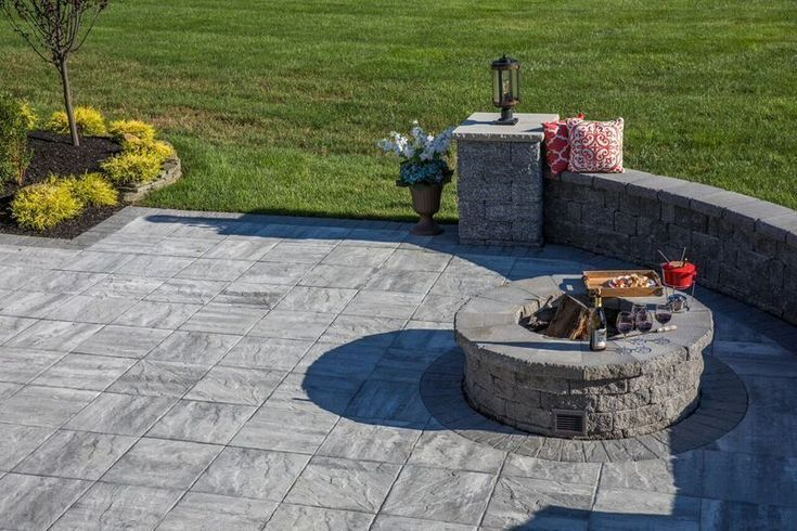 Would you roast marshmallows with this fire pit? This patio features Cambridge Pavingstones and a Cambridge Fire Pit. Installation: Mike Pantina Landscaping & Masonry