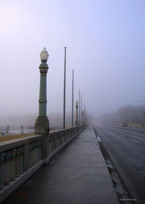 Regina, Saskatchewan. The famous Albert Street bridge on a cool foggy autumn morning. This bridge holds the world record for longest bridge over shortest body of water.