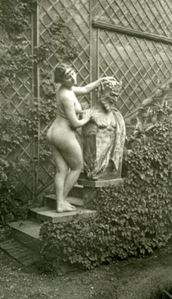 Nana multitasks - tidying up the garden and working on her tan: Vintage Nudes