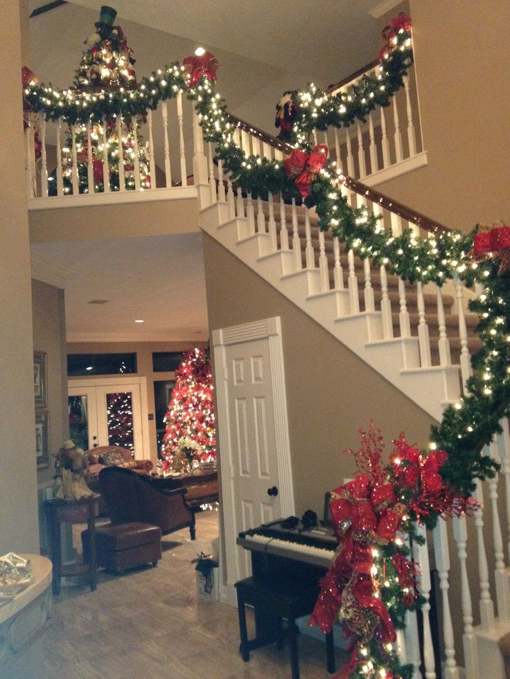 25 best ideas about christmas staircase on pinterest for Stair railing decorated for christmas