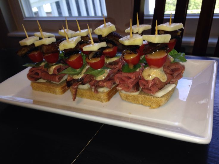 """A fresh Appetizer or horderves  Skewer Jicama Thick cut ribbon skewered deli beef Peppercorn mayo with horseradish and lime curd Halfed grape tomato  Grilled portobello mushroom Havarti cheese  Placed on 4x4"""" sour dough bread so they won't tip"""