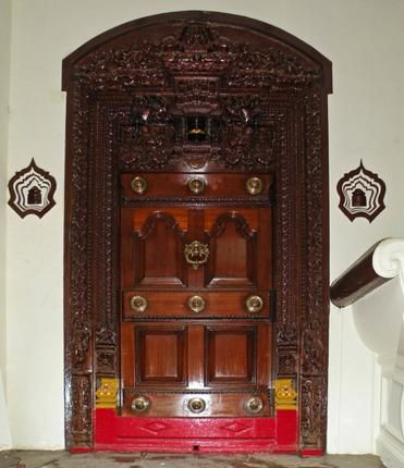 Thalai Vaasal The ornate main door of a chettiar house