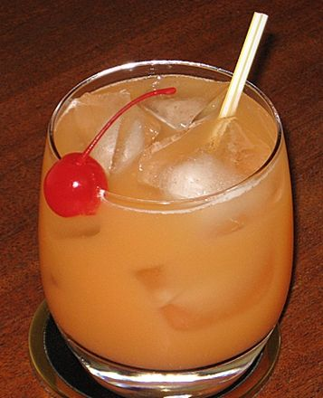 57 Chevy | 1 oz. Southern Comfort  1 oz. Gin  1 oz. Peach Schnapps  1 oz. Orange Juice  1 oz. Pineapple Juice  .5 oz Grenadine  Cherry or Pineapple Wedge to garnish