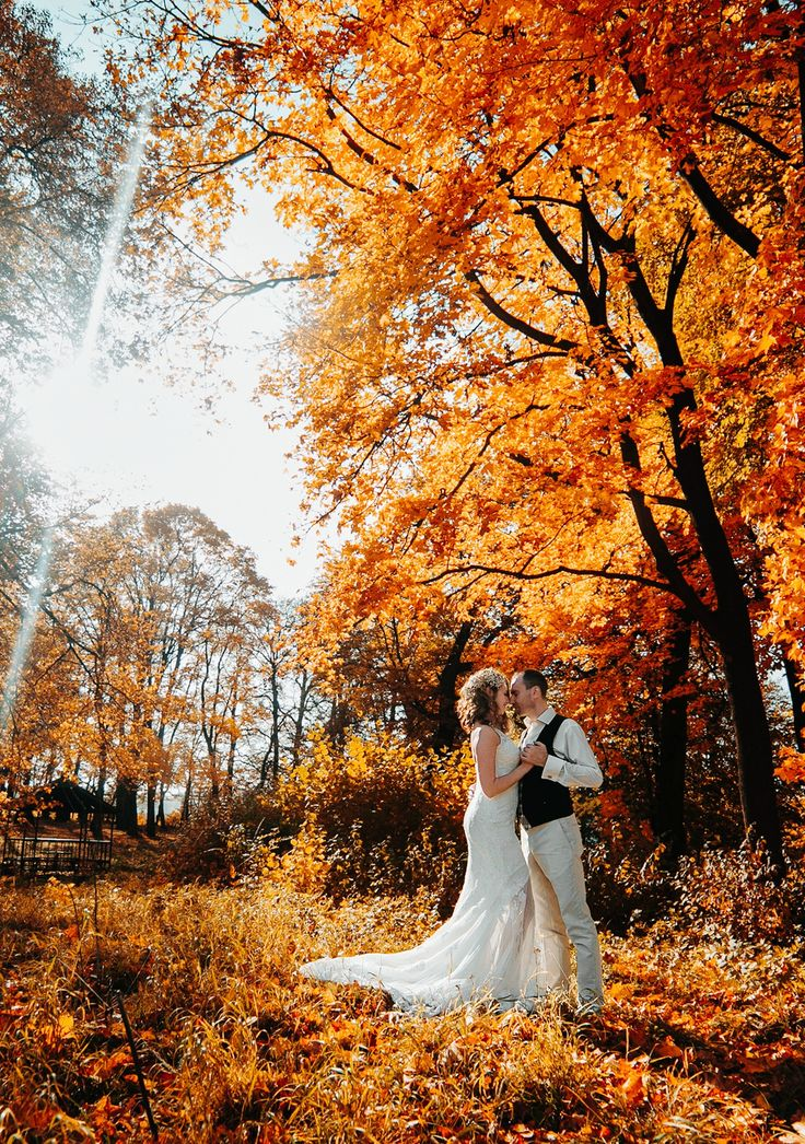 34 Stunning Fall Wedding Photos to Copy - Gorgeous outdoor shot of the Bride and Groom set against vibrant fall leaves