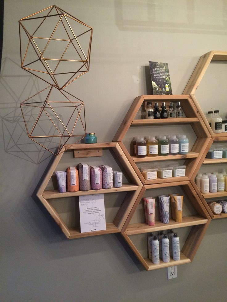 Another really cool idea for showcasing products for sale in your salon. Modern hanging shelves with geometric patterns and matching accessories is so cool!